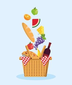 Cestino con frutti sani nella decorazione della tovaglia