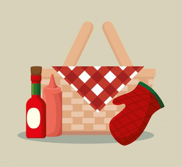 Cestino di vimini barbecue con bottiglie e guanti
