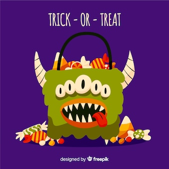 Cesto di mostri di halloween pieno di caramelle e dolci