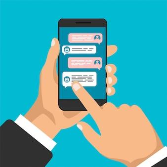 Chat bot. la mano tiene smartphone con finestre di dialogo e fare clic su di esso. design piatto di bolle di messaggistica. chiacchierando tra robot e umano. illustrazione.