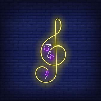 Chiave di violino fatta di auricolari con cavo al neon