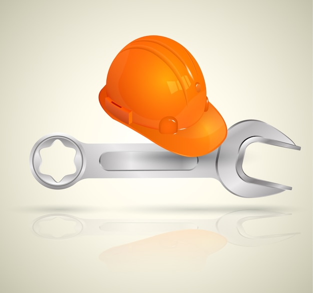 Chiave inglese e casco per lavoratore industriale