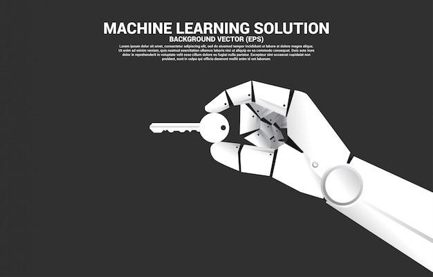 Chiuda sulla mano del robot tenga il tasto. concetto per soluzione ai e successo chiave