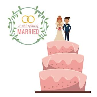 Ci sposiamo con la torta nuziale con una coppia sposata