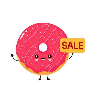 Ciambella sorridente felice sveglia con il segno di vendita. isolato su sfondo bianco ciambella, concetto di menu di panetteria