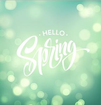 Ciao primavera con bokeh e scritte a mano.