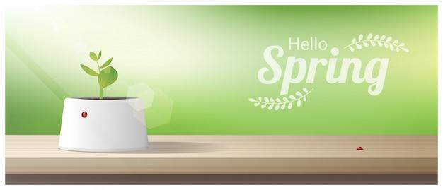 Ciao primavera sfondo con giovani germogli che crescono in una pentola