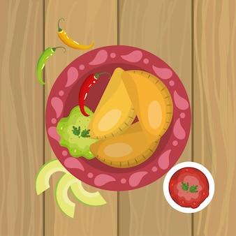 Cibo messicano con salsa piccante con avocado