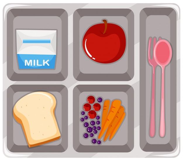 Cibo per mensa con frutta e latte