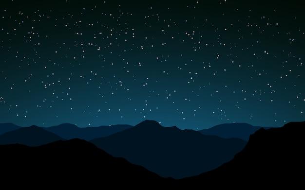 Cielo stellato sopra le cime delle montagne
