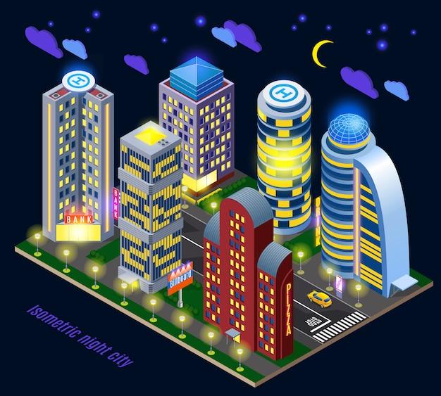 Città di notte con edifici alti illuminati e strada