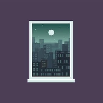 Città di notte dalla vista della finestra