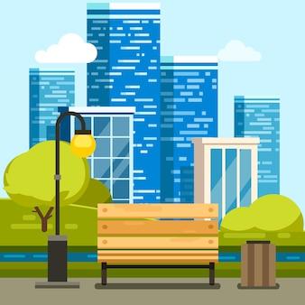 City park con panchina e grattacieli del centro
