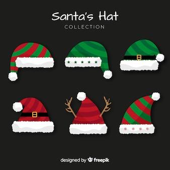 Classica collezione di cappelli da babbo natale con design piatto