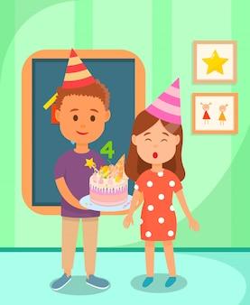 Classmate boy holding cake per birthday girl.