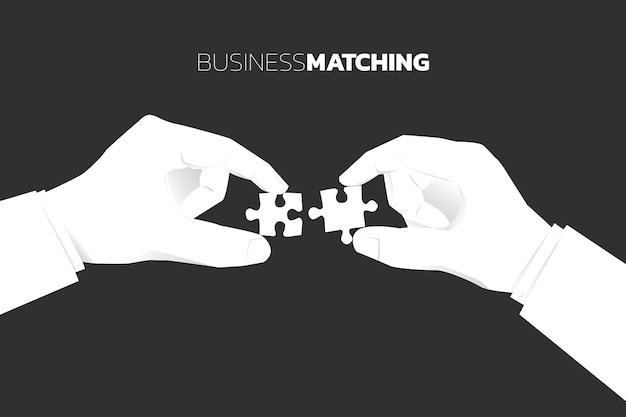 Close up due mano d'affari mettere il pezzo di puzzle per adattarsi insieme. affari concetto aziendale