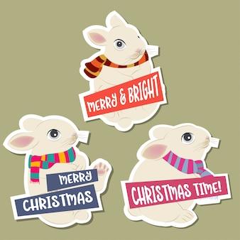 Collezione di adesivi natalizi con conigli e auguri. design piatto. vettore