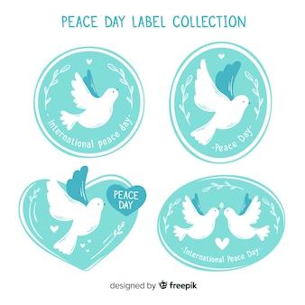 Collezione di badge colomba giorno della pace disegnati a mano