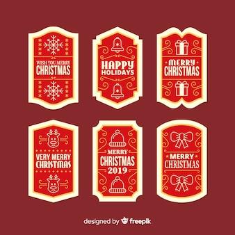 Collezione di badge di natale in design piatto