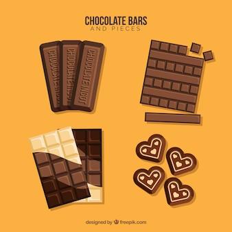 Collezione di barrette e pezzi di cioccolato con forme e sapori diversi