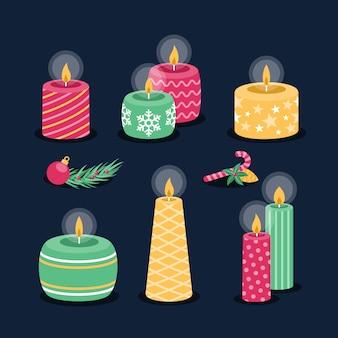 Collezione di candele di natale in design piatto