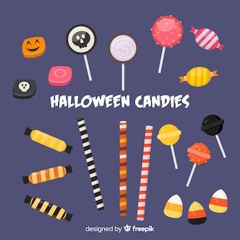 Collezione di caramelle di halloween colorato con design piatto