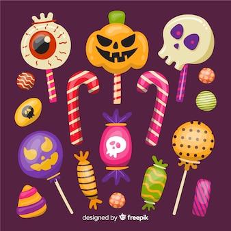 Collezione di caramelle di halloween su design piatto