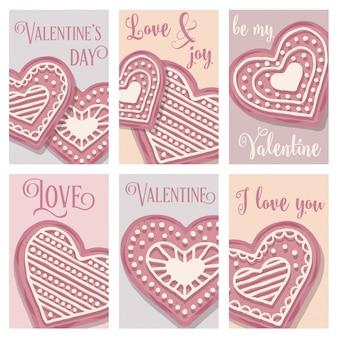 Collezione di carte di amore con biscotti cuore rosa