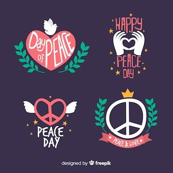 Collezione di etichette giorno della pace disegnati a mano