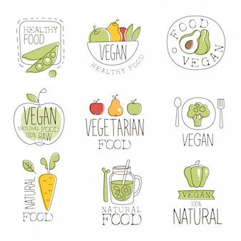 Collezione di etichette promozionali di cibi crudi e sani vegani