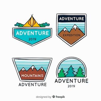 Collezione di logo avventura disegnata a mano