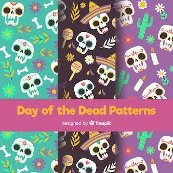 Collezione di modelli colorati di de muertos con design piatto