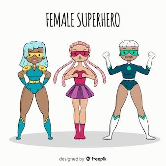 Collezione di personaggi femminili supereroi disegnati a mano