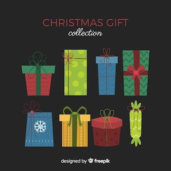 Collezione di scatole regalo di natale in design piatto