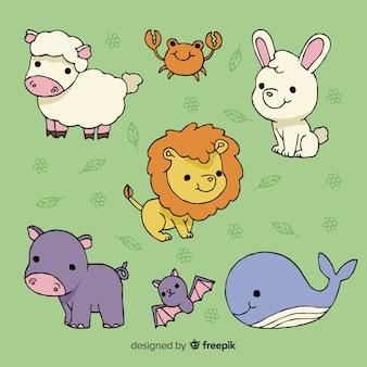 Collezione di simpatici animali su sfondo verde