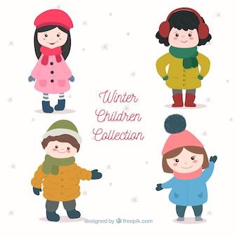 Collezione di simpatici bambini invernali disegnata a mano