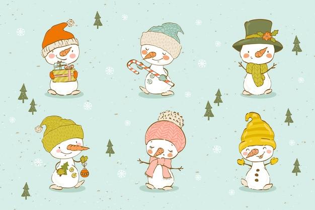 Collezione di simpatici pupazzi di neve disegnati a mano.