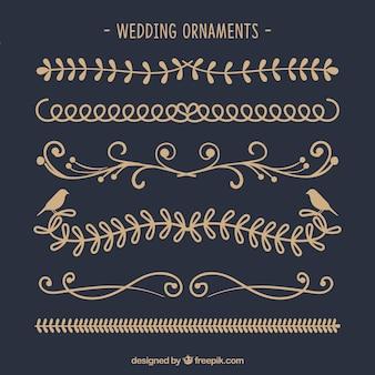 Collezione disegnata a mano di ornamenti di nozze
