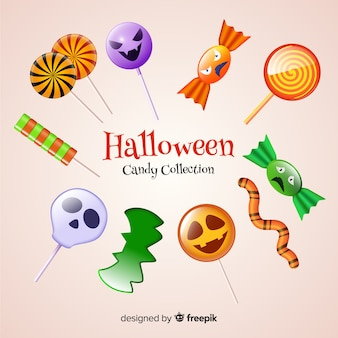 Collezione realistica di caramelle di halloween su sfondo giallo pallido