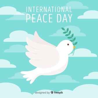 Composizione del giorno della pace con colomba bianca piatta