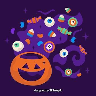 Composizione della parte posteriore della caramella di halloween nel desing piano