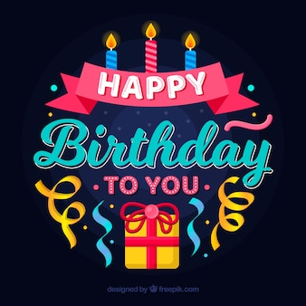 Composizione di compleanno con regalo e candele