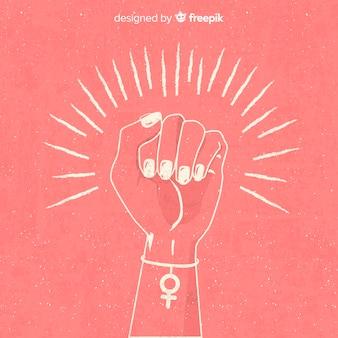 Composizione di femminismo con pugno disegnato a mano
