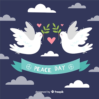 Composizione di giorno di pace con colomba bianca disegnata a mano