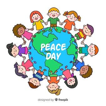 Composizione di giorno di pace con i bambini che si tengono per mano il mondo
