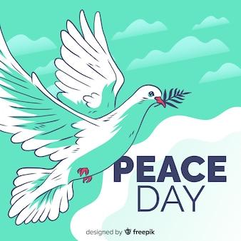 Composizione di giorno di pace con la colomba bianca disegnata a mano
