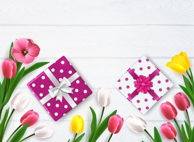 Composizione in festa della mamma con la vista superiore dei contenitori e dei fiori di regalo del pois sull'illustrazione di legno di vettore del fondo