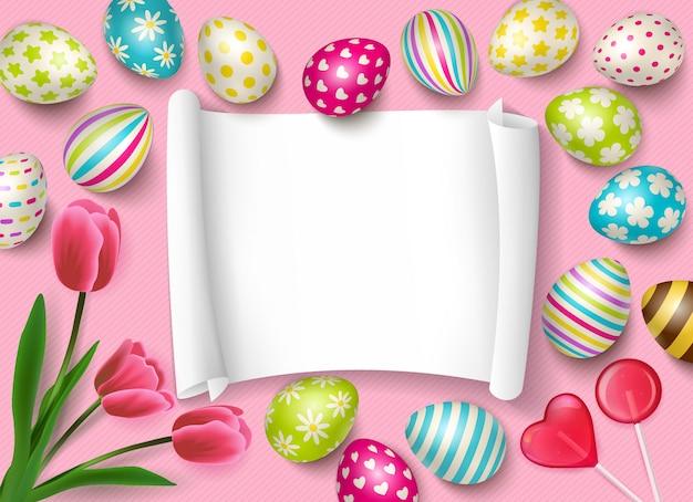 Composizione in pasqua con la struttura di carta vuota per il testo di congratulazioni e le immagini dell'illustrazione dei dolci e dei fiori delle uova