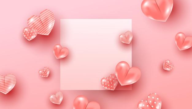 Composizione minima creativa con un modello di cuori palloncino rosa che volano in aria intorno a una cornice di carta su uno sfondo rosa