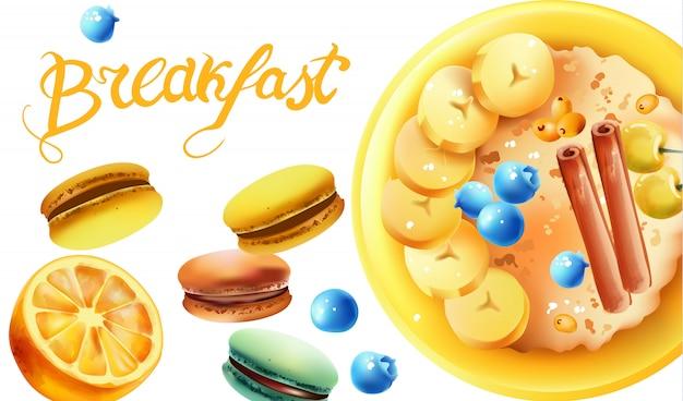 Composizione sana colazione con una ciotola di farina d'avena, ciliegie bianche, mirtilli, fettine di banana, bastoncini di cannella, macarons e limone